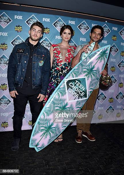 Actors Cody Christian Shelley Hennig and Tyler Posey pose with the Choice Summer TV Show award for 'Teen Wolf' in the press room during Teen Choice...