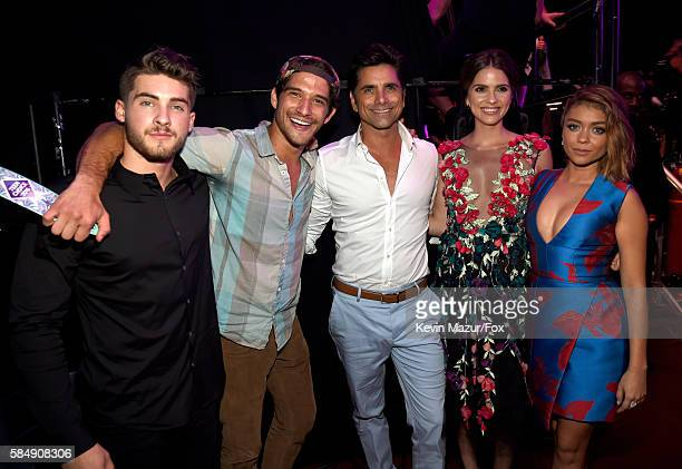 Actors Cody Christian Tyler Posey John Stamos Shelley Hennig and Sarah Hyland attend the Teen Choice Awards 2016 at The Forum on July 31 2016 in...