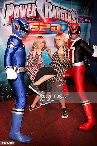 Actors Cole Sprouse and Dylan Sprouse pose with Power Rangers at the Hollywood Radio and Television Society presents 'Kids Day 2005' at the Hollywood...