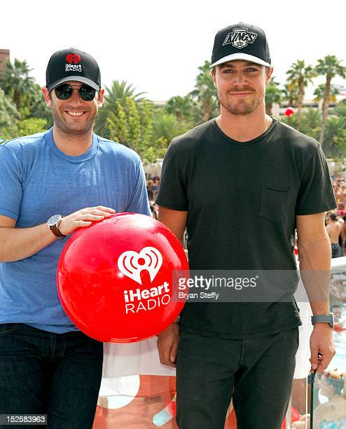Actors Colin Donnell and Stephen Amell attend the 2012 iHeartRadio Music Festival pool party at the Wet Republic pool at the MGM Grand Hotel/Casino...