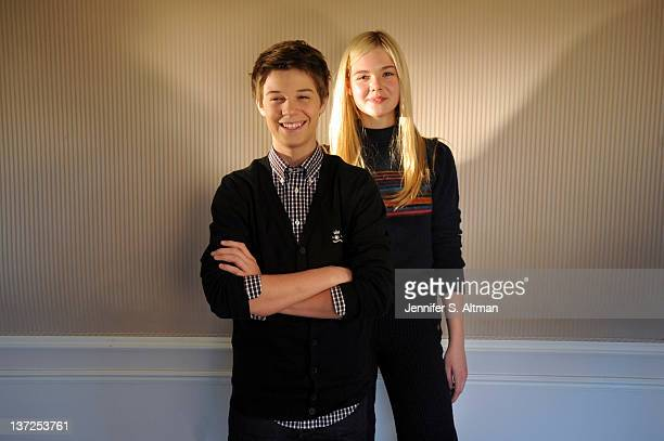 Actors Colin Ford and Elle Fanning are photographed for Los Angeles Times on December 9 2011 in New York City PUBLISHED IMAGE