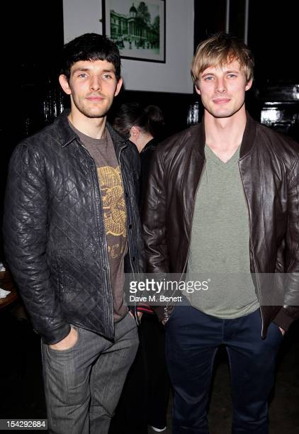 Actors Colin Morgan and Bradley James attend an after party following the press night performance of 'Loserville' at the National Cafe on October 17...