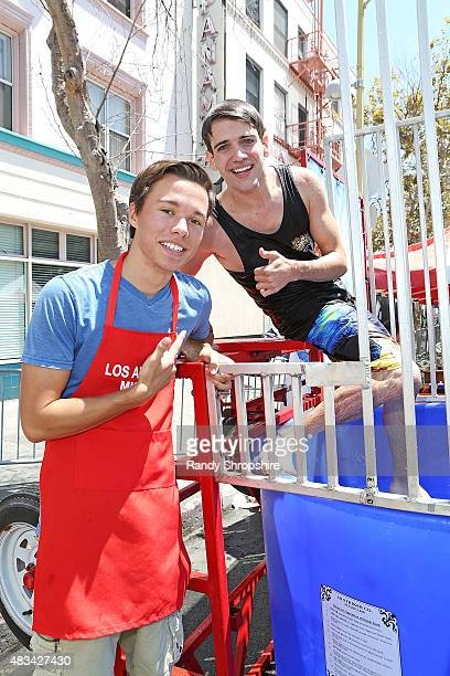 Actors Colton Shires and Brandon Tyler Russell attend the End of Summer Block Party at Los Angeles Mission on August 8 2015 in Los Angeles California