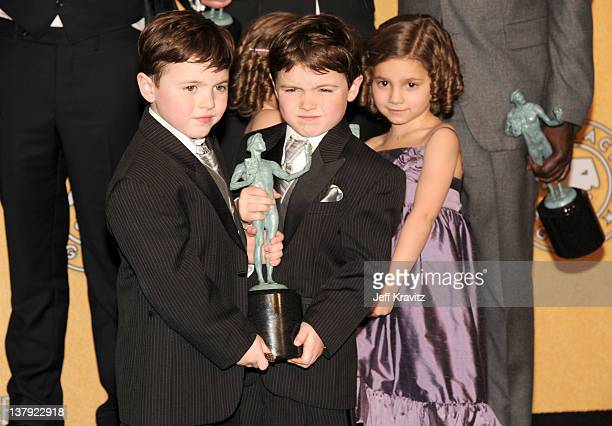 Actors Connor Noon Brady Noon Lucy Gallina pose in the press room during the 18th Annual Screen Actors Guild Awards at The Shrine Auditorium on...