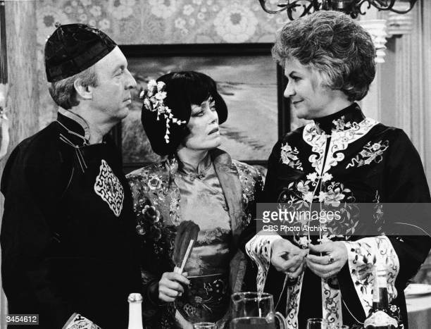 Actors Conrad Bain Rue McLanahan and Beatrice Arthur wear Asian costumes in a still from the TV series 'Maude' 1978
