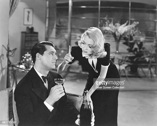 Actors Constance Bennett as Marion Kerby and Cary Grant as George Kerby in the film 'Topper' 1937