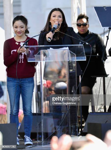 Actors Constance Wu and Eva Longoria speak during the Women's March Los Angeles 2018 on January 20 2018 in Los Angeles California