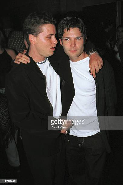 Actors Corey Haim and Corey Feldman pose outside Las Palmas club October 17 2001 in Hollywood CA