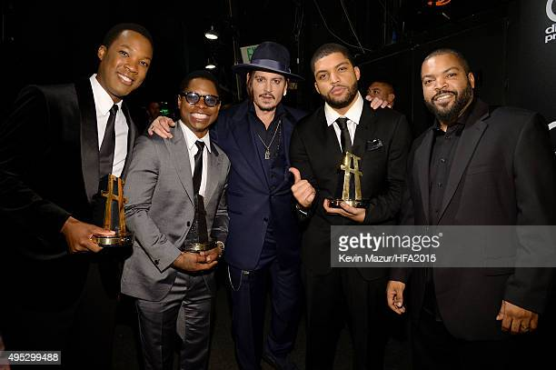 Actors Corey Hawkins Jason Mitchell Johnny Depp O'Shea Jackson Jr and Ice Cube pose with the Hollywood Breakout Ensemble Award for 'Straight Outta...