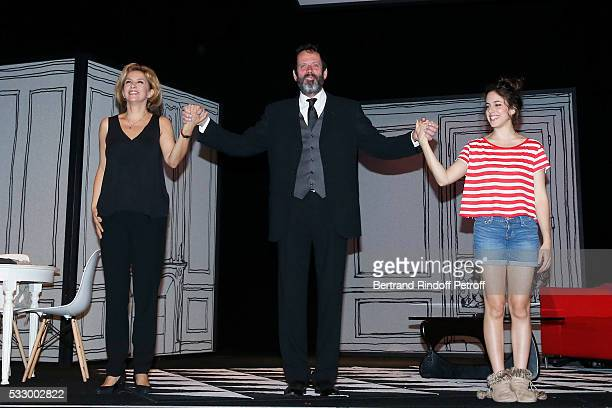Actors Corinne Touzet, Christian Vadim and Fanny Guillot acknowledge the applause of the audience at the end of the 100th representation of the...