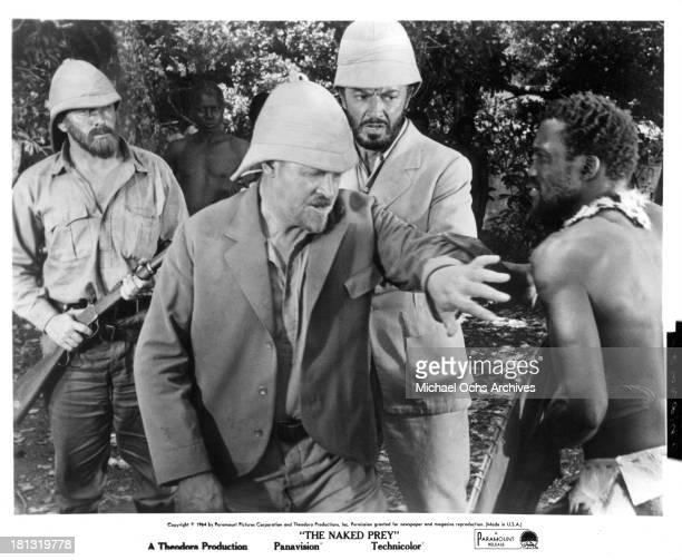 Actors Cornel Wilde and Gert van den Bergh on the set of the Paramount Release movie The Naked Prey in 1966