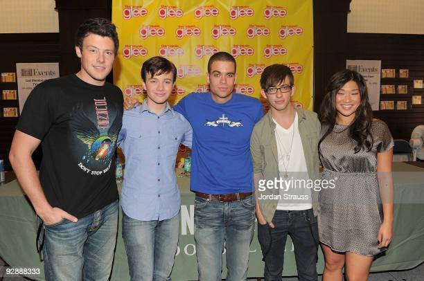 Actors Cory Monteith Chris Colfer Mark Salling Kevin McHale and Jenna Ushkowitz and pose as the cast of Glee signs copies of Glee The Music Vol 1 at...
