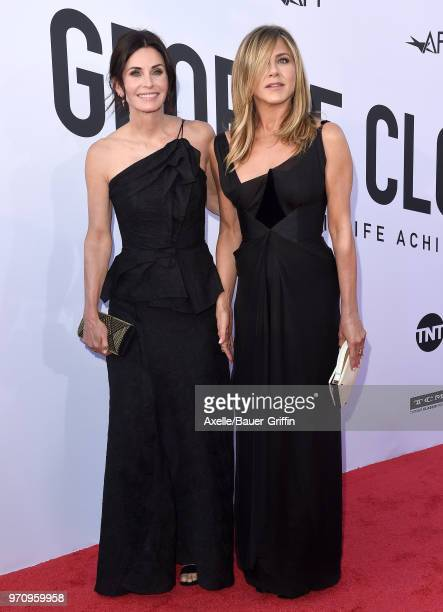 Actors Courteney Cox and Jennifer Aniston arrive at the American Film Institute's 46th Life Achievement Award Gala Tribute to George Clooney on June...