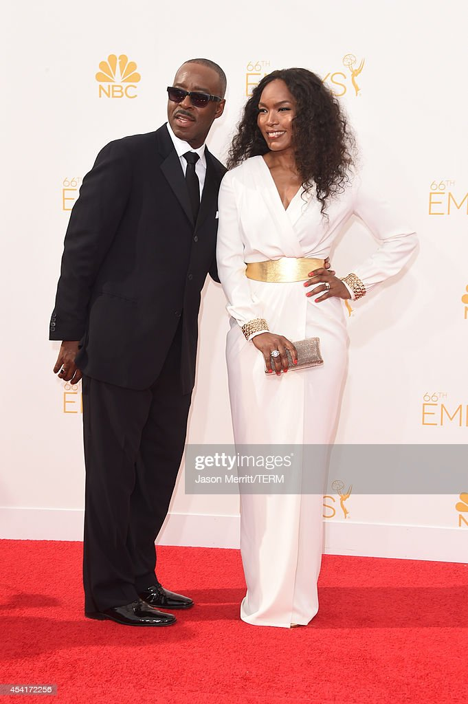 Actors Courtney B. Vance (L) and Angela Bassett attend the 66th Annual Primetime Emmy Awards held at Nokia Theatre L.A. Live on August 25, 2014 in Los Angeles, California.