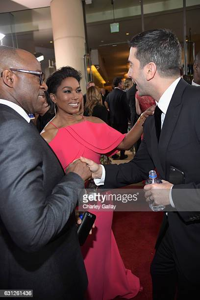 Actors Courtney B Vance Angela Bassett and David Schwimmer at the 74th annual Golden Globe Awards sponsored by FIJI Water at The Beverly Hilton Hotel...