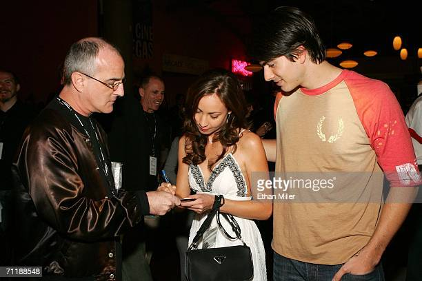 Actors Courtney Ford and Brandon Routh signs autographs as they arrive at the Denial screening at the Brenden Theatres inside the Palms Casino Resort...