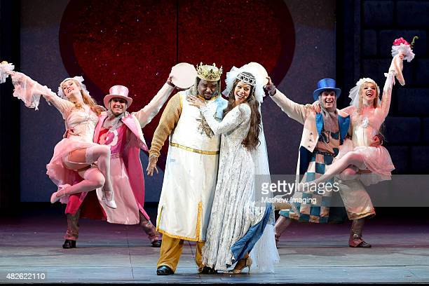 Actors Craig Robinson and Merle Dandridge perform onstage during Monty Python Spamalot at the Hollywood Bowl on July 31 2015 in Hollywood California