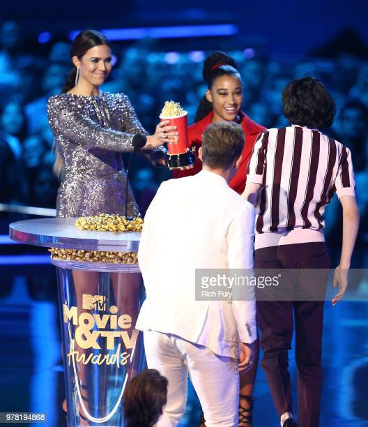 Actors Dacre Montgomery and Finn Wolfhard accept Best Show for 'Stranger Things' from actors Mandy Moore and Amandla Stenberg onstage during the 2018...
