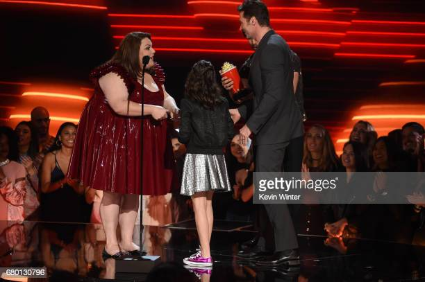 Actors Dafne Keen and Hugh Jackman accept Best Duo for 'Logan' onstage from actors Chrissy Metz and Milo Ventimiglia onstage during the 2017 MTV...