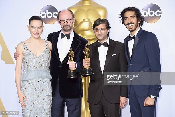 Actors Daisy Ridley and Dev Patel pose with directors James Gay-Rees and Asif Kapadia, winners of Best Documentary Feature, 'Amy' in the press room...