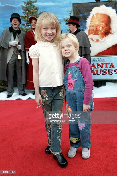 Actors Dakota and Elle Fanning attend the film premiere of The Santa Claus 2 at the El Capitan Theatre on October 27 2002 in Hollywood California The...