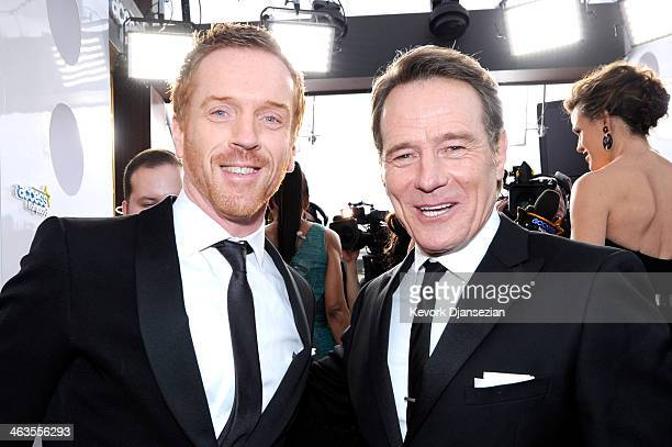 Actors Damian Lewis and Bryan Cranston attend the 20th Annual Screen Actors Guild Awards at The Shrine Auditorium on January 18 2014 in Los Angeles...