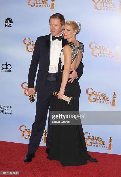Actors Damian Lewis and Claire Danes pose in the press room at the 69th Annual Golden Globe Awards held at the Beverly Hilton Hotel on January 15...