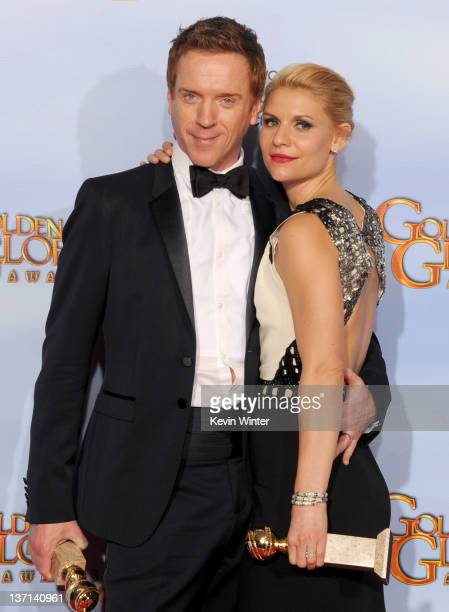 Actors Damian Lewis and Claire Danes pose in the press room with the Best Television Series Drama award for 'Homeland' at the 69th Annual Golden...