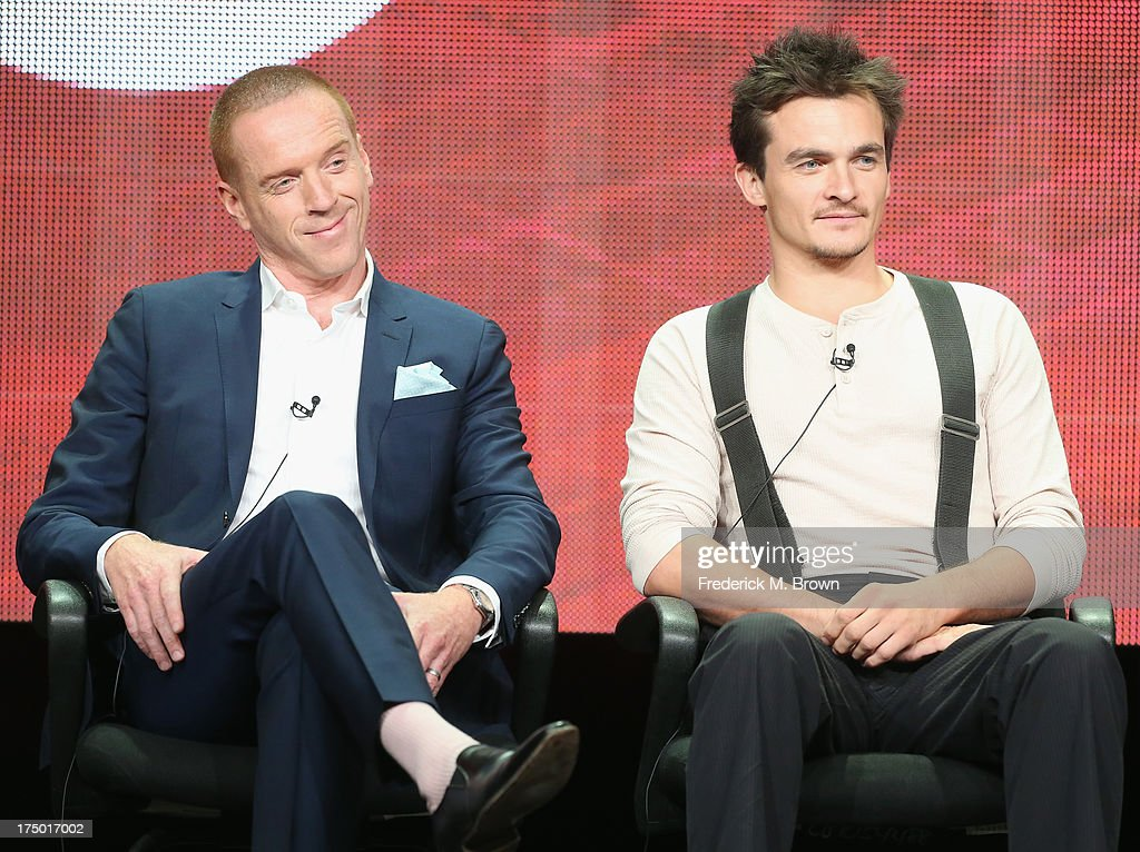 Actors Damian Lewis and Rupert Friend speak onstage during the 'Homeland' panel discussion at the CBS, Showtime and The CW portion of the 2013 Summer Television Critics Association tour at the Beverly Hilton Hotel on July 29, 2013 in Beverly Hills, California.