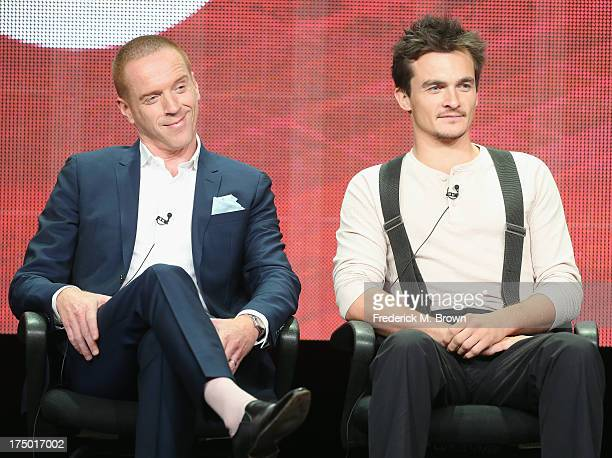 Actors Damian Lewis and Rupert Friend speak onstage during the 'Homeland' panel discussion at the CBS Showtime and The CW portion of the 2013 Summer...