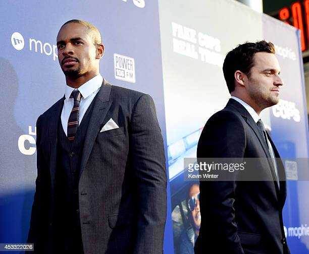 "Actors Damon Wayans Jr. And Jake Johnson arrive at the premiere of Twentieth Century Fox's ""Let's Be Cops"" at the Cinerama Dome on August 7, 2014 in..."