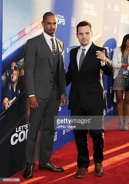 Actors Damon Wayans Jr and Jake Johnson attend the 'Let's Be Cops' Los Angeles Premiere held at the ArcLight Hollywood on August 7 2014 in Hollywood...
