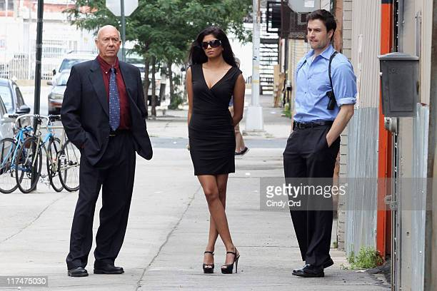 Actors Dan Florek Kavita Kaushik and Ryan Farrell on the set of the Eve to Adam Run Your Mouth music video shoot at Streets of Brooklyn on June 26...