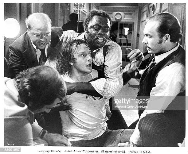 Actors Dana ElcarTony King Michael Moriarty and Hector Elizondo on set of the United Artists movie 'Report to the Commissioner' in 1975