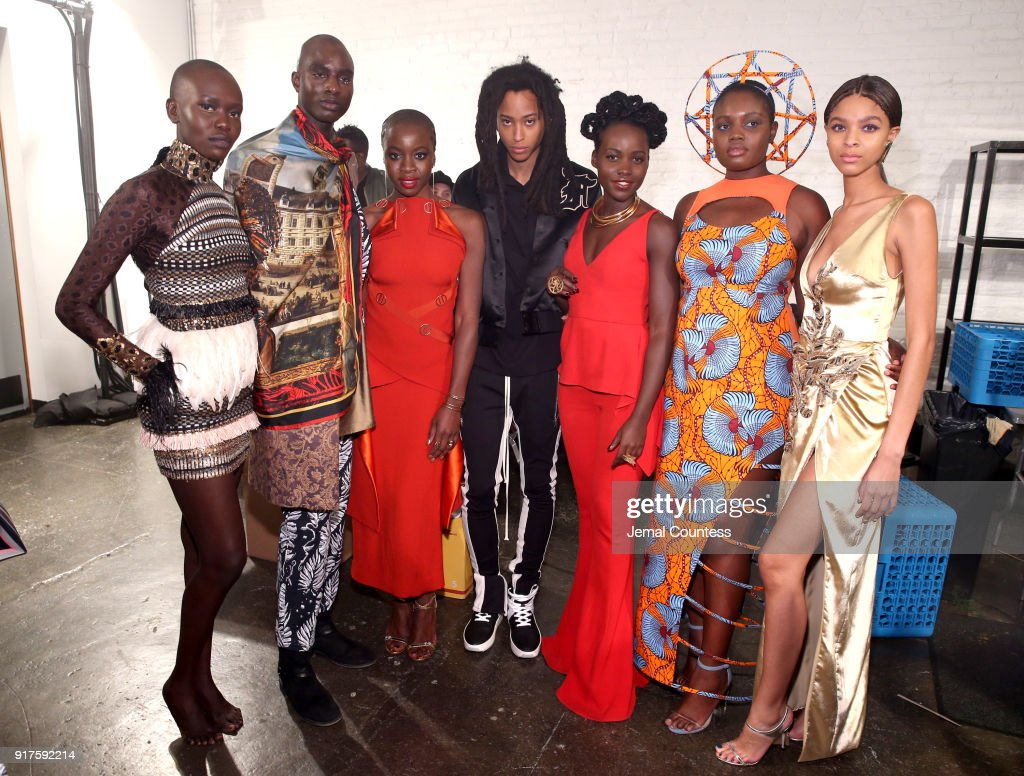 Actors Danai Gurira and Lupita Nyong'o pose backstage with models during the Marvel Studios Black Panther Welcome to Wakanda New York Fashion Week Showcase at Industria Studios on February 12, 2018 in New York City.