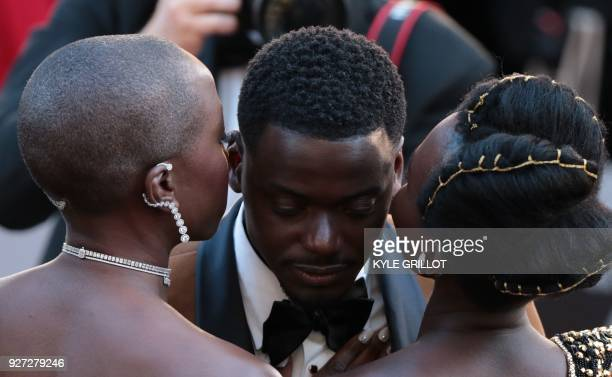 TOPSHOT Actors Danai Gurira Daniel Kaluuya and Lupita Nyong'o arrive for the 90th Annual Academy Awards on March 4 in Hollywood California / AFP...