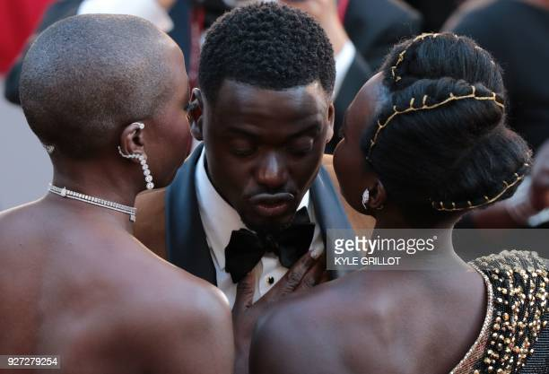Actors Danai Gurira Daniel Kaluuya and Lupita Nyong'o arrive for the 90th Annual Academy Awards on March 4 in Hollywood California / AFP PHOTO / Kyle...