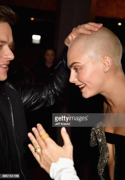 Actors Dane DeHaan and Cara Delevingne attend the 2017 MTV Movie And TV Awards at The Shrine Auditorium on May 7 2017 in Los Angeles California