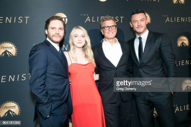 Actors Daniel Bruh Dakota Fanning Kevin Reilly and Luke Evans attend the Premiere Of TNT's 'The Alienist' on January 11 2018 in Hollywood California