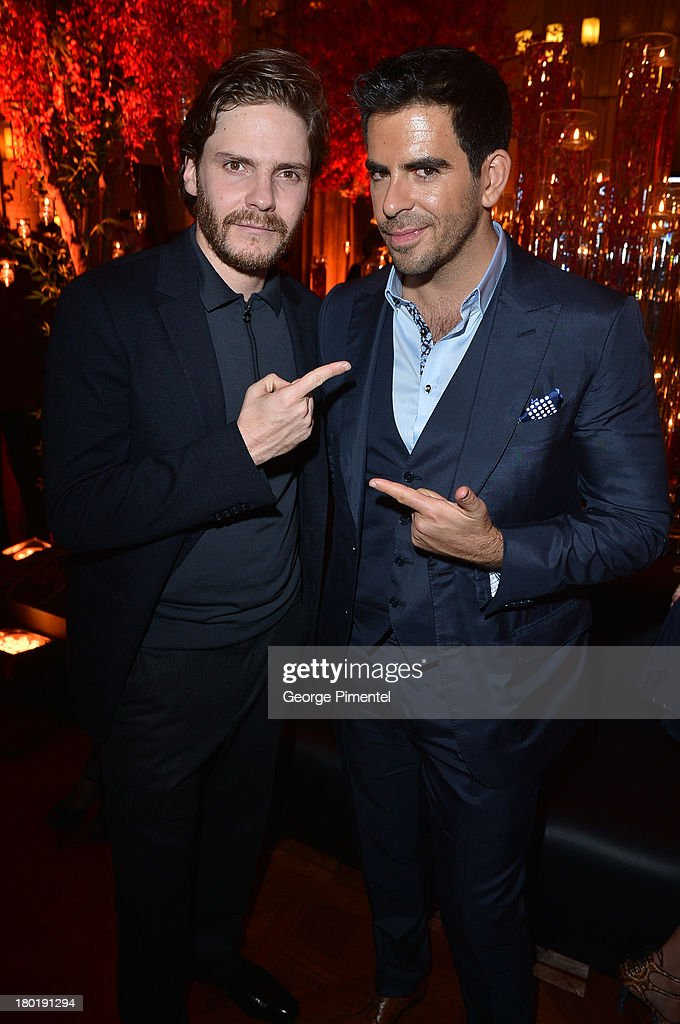 Actors Daniel Bruhl and Eli Roth attend InStyle and the Hollywood Foreign Press Association's Annual Toronto International Film Festival Party, hosted by Salvatore Ferragamo on Monday, September 9, 2013 held at the Windsor Arms Hotel in Toronto, Canada.