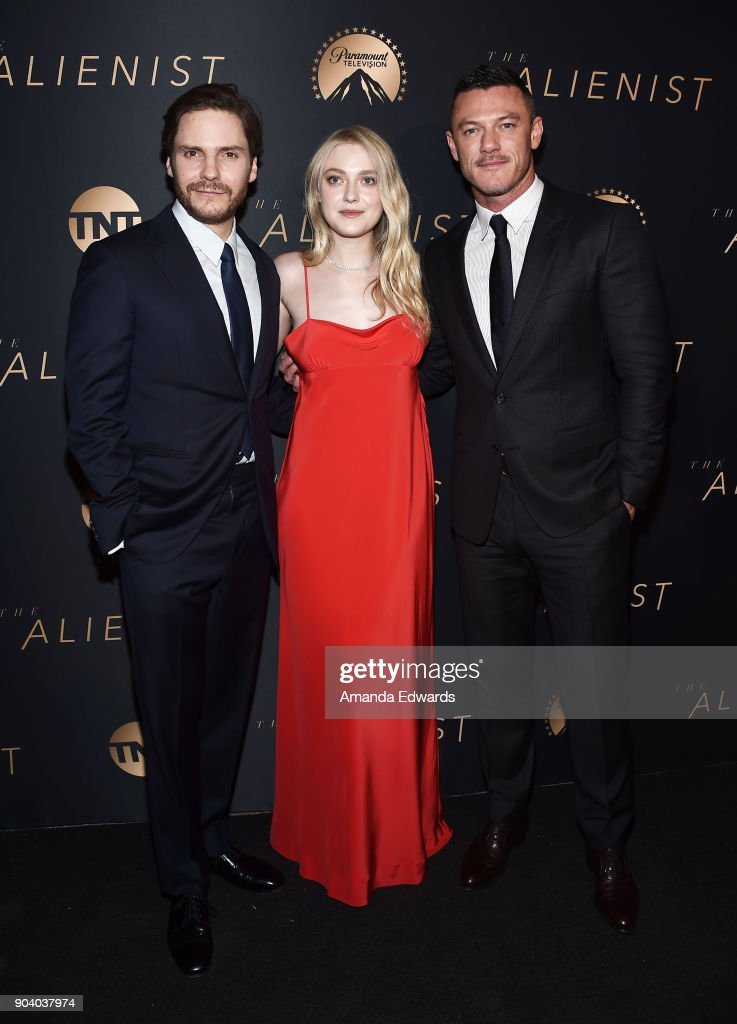Actors Daniel Bruhl, Dakota Fanning and Luke Evans arrive at the premiere of TNT's 'The Alienist' at The Paramount Lot on January 11, 2018 in Hollywood, California.