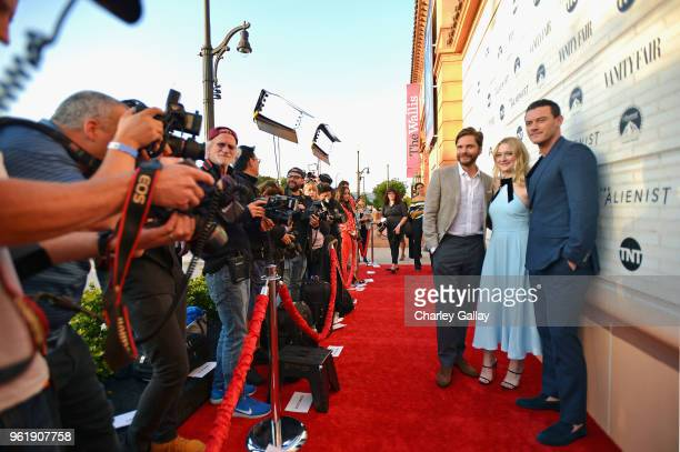 Actors Daniel Bruhl Dakota Fanning and Luke Evans attend The Alienist Los Angeles For Your Consideration Event at Wallis Annenberg Center for the...