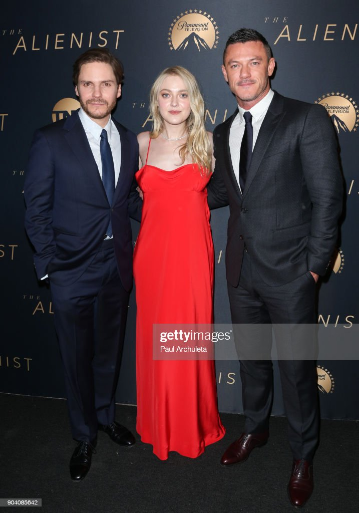 Actors Daniel Bruhl, Dakota Fanning and Luke Evans attend the premiere of TNT's 'The Alienist' at The Paramount Lot on January 11, 2018 in Hollywood, California.