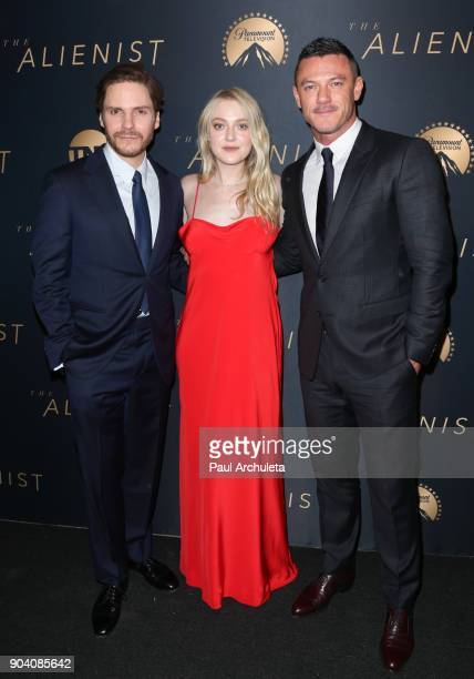 """Actors Daniel Bruhl, Dakota Fanning and Luke Evans attend the premiere of TNT's """"The Alienist"""" at The Paramount Lot on January 11, 2018 in Hollywood,..."""