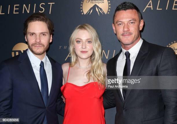 Actors Daniel Bruhl Dakota Fanning and Luke Evans attend the premiere of TNT's 'The Alienist' at The Paramount Lot on January 11 2018 in Hollywood...