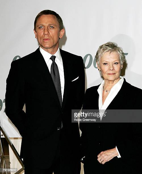 Actors Daniel Craig and Dame Judi Dench attend a photocall to celebrate the start of production of the 22nd James Bond film 'Quantum of Solace' at...