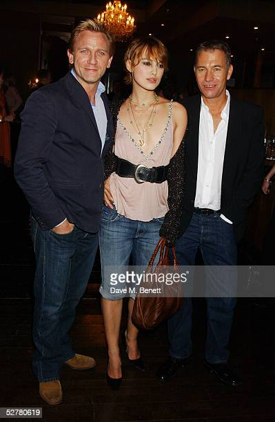 Actors Daniel Craig Keira Knightley and director John Maybury attend the screening of The Jacket at the Rex Cinema and bar on May 9 2005 in London...