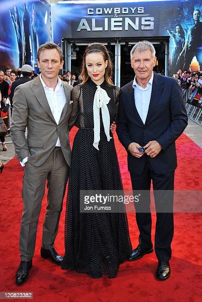 Actors Daniel Craig Olivia Wilde and Harrison Ford attend the Cowboys Aliens UK premiere at Cineworld 02 Arena on August 11 2011 in London England