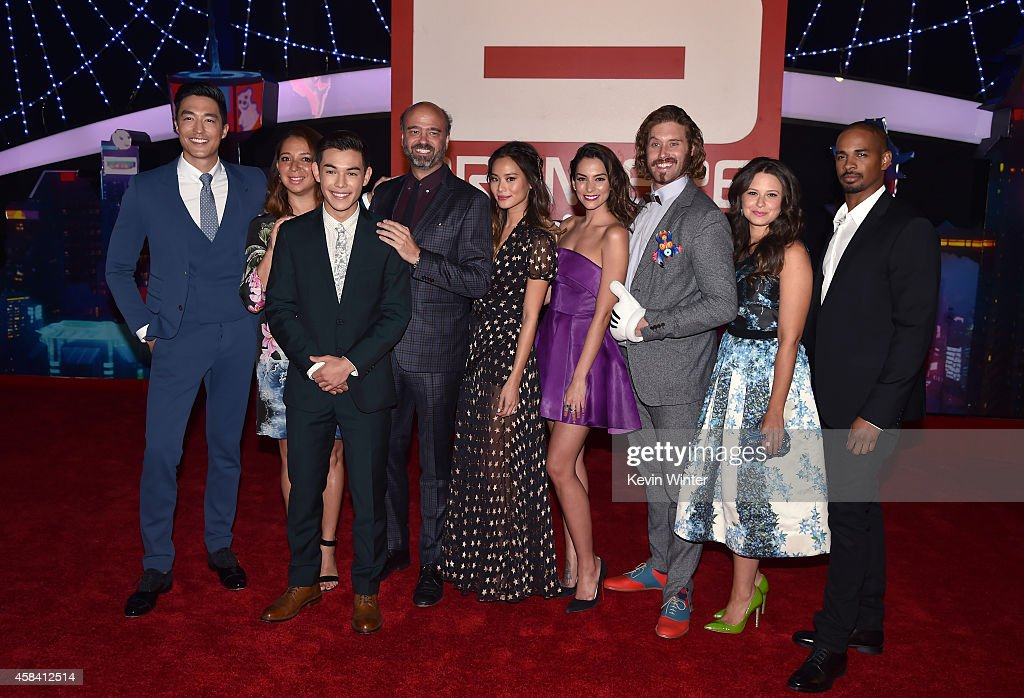 Actors Daniel Henney, Maya Rudolph, Ryan Potter, Scott Adsit, Jamie Chung, Genesis Rodriguez, T.J. Miller, Katie Lowes and Damon Wayans Jr. attend the premiere of Disney's 'Big Hero 6' at the El Capitan Theatre on November 4, 2014 in Hollywood, California.