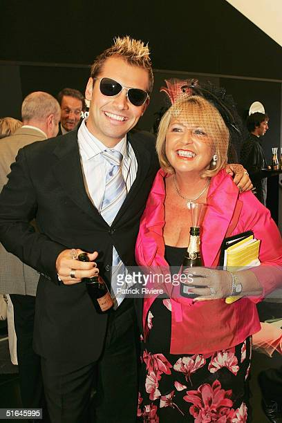 Actors Daniel MacPherson and his mother Anne pose at the Moet et Chandon maquee attend The Melbourne Cup at Flemington Racecourse November 2 2004 in...